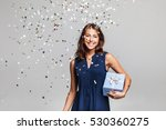 beautiful happy woman with gift ... | Shutterstock . vector #530360275