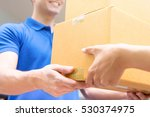 delivery man in blue uniform... | Shutterstock . vector #530374975