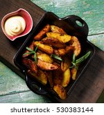 roasted potato wedges with... | Shutterstock . vector #530383144