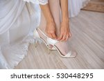 the bride wears white shoes on...   Shutterstock . vector #530448295