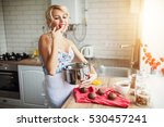attractive girl cooking on her... | Shutterstock . vector #530457241