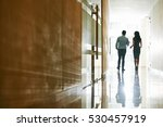 talking coworkers walking along ... | Shutterstock . vector #530457919