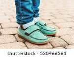 Close Up Of Green Moccasins On...