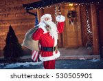 santa claus holding his bag and ... | Shutterstock . vector #530505901