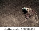 tractor plowing field  top view ... | Shutterstock . vector #530509435