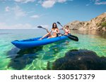 two young women kayaking in the ... | Shutterstock . vector #530517379