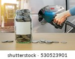 money bottle with coins  hand... | Shutterstock . vector #530523901