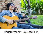 hipster man playing guitar for... | Shutterstock . vector #530551144