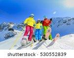 Skiing Family Enjoying Winter...