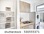modern laundry room with... | Shutterstock . vector #530555371