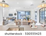 modern dining room with kitchen ... | Shutterstock . vector #530555425