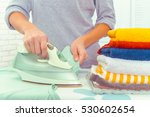 closeup of woman ironing... | Shutterstock . vector #530602654