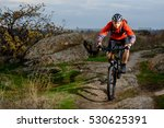 cyclist in red jacket riding...   Shutterstock . vector #530625391
