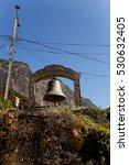 Small photo of Monument near sacred mountain Adam's Peak in Sri Lanka