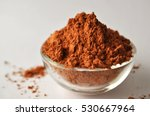 Montmorillonite red clay powder in a glass bowl isolated