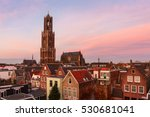 The Strosteeg (Straw Alley) and Dom Tower of the St. Martins Cathedral at sunset, Utrecht, The Netherlands. The Dom Tower is the tallest church tower of The Netherlands.