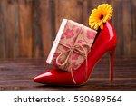 present box near shoe. flower ... | Shutterstock . vector #530689564