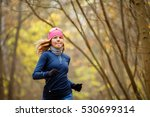 young female running in morning | Shutterstock . vector #530699314
