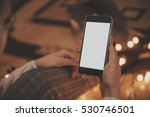 girl using mobile phone in a...   Shutterstock . vector #530746501