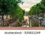 Bikes Parked On A Bridge In...