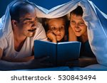 reading family in bed | Shutterstock . vector #530843494