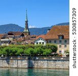 Small photo of Solothurn, Switzerland - 10 July, 2016: historic buildings along the Aare river, mountains in the background. The city of Solothurn is the capital of the Swiss Canton of Solothurn.