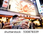 tourist showing grilled big...   Shutterstock . vector #530878339
