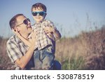 father and son playing on the... | Shutterstock . vector #530878519