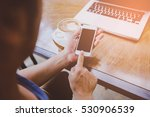 man using smart phone in cafe.... | Shutterstock . vector #530906539