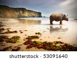 Surreal scene of a big Rhinoceros in an empty beach - stock photo