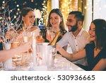 friends celebrating christmas... | Shutterstock . vector #530936665
