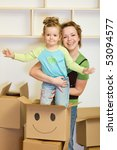 Moving into a new home concept with people and cardboard boxes - stock photo