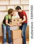 Happy family with a kid moving into a new home concept - stock photo