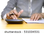 female accounting using a... | Shutterstock . vector #531034531