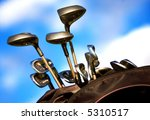 golf clubs in a bag over a beautiful blue sky in the background - stock photo