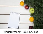 notebook fruit and spruce on a... | Shutterstock . vector #531122155