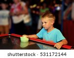 a child plays hockey on a table | Shutterstock . vector #531172144