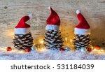 Red Santa Hats On Rustic Pine...