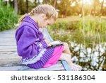 little beautiful girl sitting... | Shutterstock . vector #531186304