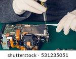 close up hands of a technician... | Shutterstock . vector #531235051