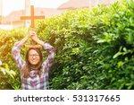 christian woman holding wooden... | Shutterstock . vector #531317665