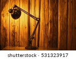 Table Top Lamp Lit Over A...