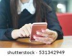 woman using a smartphone. | Shutterstock . vector #531342949