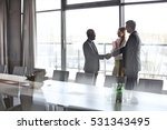 businessmen shaking hands by... | Shutterstock . vector #531343495