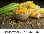 Bowl With Corn Seeds And Ripe...