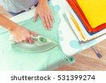 closeup of woman ironing... | Shutterstock . vector #531399274