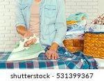 closeup of woman ironing... | Shutterstock . vector #531399367