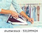 closeup of woman ironing... | Shutterstock . vector #531399424