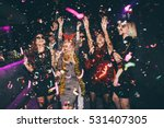 Small photo of Group of friends at club having fun. New year's party