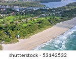 aerial view of beautiful municipal beach and waterfront golf course in south florida - stock photo